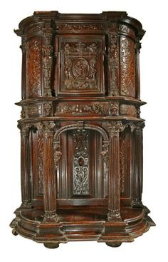 """Bunratty Castle Medieval Collection French mid 16th century Renaissance walnut cabinet, Object: Cupboard   Description: French mid 16th century Renaissance walnut cabinet, the upper section with central door and rounded side panels, superbly carved with scrolling designs etc., caryatid supporters. The arcaded base within Corinthian columns, and platform below. Highest quality.  Wood/Walnut Measurements Metric: 89cm H x 100cm L x 55cm W Measurements Imperial: 35""""H x 39½""""L x 21½cm W"""