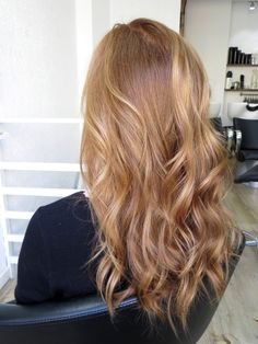 Stunning light copper hair with darker roots and natural balayage hihglights