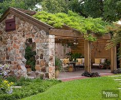 Relieved of its tin roof and doors, this old four-bay carriage house was reincarnated as an expansive 20x40-foot, open-air, outdoor living space. Original stone walls and a lush growth of wisteria atop a new rafter pergola create a rustic connection to the landscape.