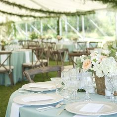 A tent draped in ferns, the tables adorned in robins egg blues and peaches and lush greens.. The wedding in Jackson Hole with Fleur de V Events, Carrie Patterson and Elizabeth Kelleher was utterly breathtaking | Table settings: Our White Lace Chargers + White Collection Vintage China + Antique Silver Flatware + Vintage Cut Crystal/Pressed Glass/Champagne Coupe Stemware + Antique Crystal Salt Cellars // Casa de Perrin