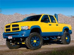 bright yellow and blue dodge ram 2500 lifted truck