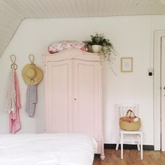 pale pink armoire. lovely.