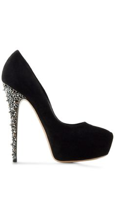 Lightly studded heel. Not a lot of studs though. Something like this that is just a slender heel with stud details.