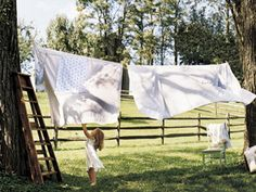 outdoor clothesline..nothing smells better than fresh sheets dried out in the sunshine :)