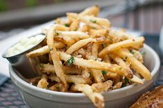 Parmesan Truffle Fries! No recipe here, but hey. You make some thin fries, par-fry them, then fry again. Immed after doneness, sprinkle w/ sea salt, drizzle w/ truffle olive oil and delight in shaved parm. Parsley, garlic, whatever is up to you. Just get the oil and the parm. After that, oooo.
