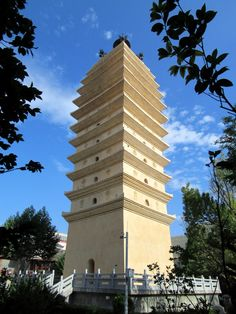 The East Pagoda (Dong Si Ta) in Kunming, Yunnan, China, dates back to the Tang Dynasty AD). Kunming, Dates, Skyscraper, Multi Story Building, China, Stone, Travel, Rice, Skyscrapers
