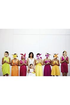 Get bridesmaids to hold colourful pin-wheel fans instead of flowers - Cheaper & more fun!