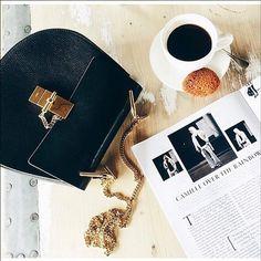 Capturing the perfect flat lay: chic bag + coffee + magazine via Bergorf's Instagram