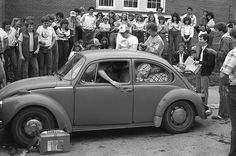 Members of Lambda Chi Alpha at the University of Nebraska- Omaha try to fill a VW bug back in the day.