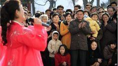 Crowd watch a singer in Pyongyang, North Korea (9 March 2014)