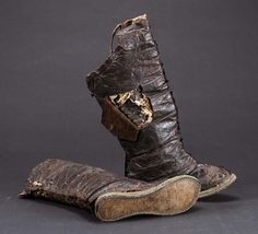Plated boots  U.63-3-53    Type 	Costume and Jewelry  Materials 	Leather, iron plates  Measurements 	56 cm., 26 cm.  Creator name 	Unknown  Where it was made 	Mongolia  Time period 	15th-16th Century  Function 	Boots worn by Mongolian warriors