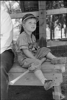 A little boy watches the baseball game on the fourth of July at Vale Oregon 1941