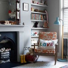 Love the shelves next to the fireplace, and the black fireplace surround.