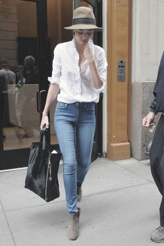 Miranda Kerr in a white shirt, skinny jeans and Isabel Marant Dicker Boots