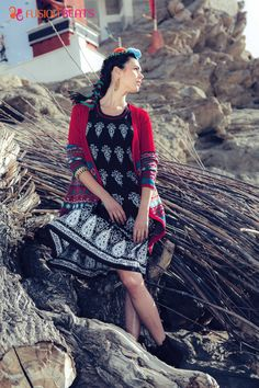 Black and white motifs kurti with bold red shrug.