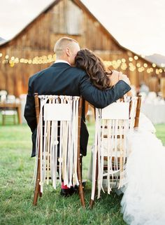 chair ribbons with sign for bride and groom chairs
