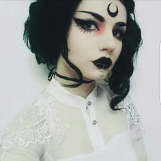 Shop this look bb!!  Eyeshadow: http://www.dollskill.com/lunatick-cosmetic-labs-elvira-palette.html Eyeliner: http://www.dollskill.com/sigma-legend-line-ace-liquid-liner.html (Perfect for drawing moons on yer forehead!) Eyelashes:  http://www.dollskill.com/black-magic-lashes-firewalker-false-eyelashes.html LIpstick: http://www.dollskill.com/lime-crime-styletto-opaque-lipstick.html Mattifying powder…