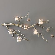 I am in love with this branch and candle wall art from West Elm. I love that it can be used year round and can also have a touch of Christmas by simply hanging ornaments from it. Hopefully I can find a knock-off version somewhere! Care to share?01k00