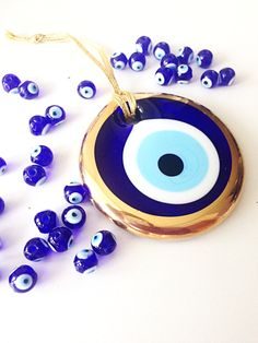 A personal favourite from my Etsy shop https://www.etsy.com/listing/291989307/gold-evil-eye-bead-10cm-evil-eye-wall