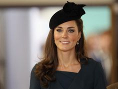 Kate in dark suit and hat