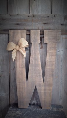 Barn Wood Letters measuring 24 inches tall with burlap bow, barn wood letters, rustic letters, rustic decor, rustic letter, guest book, by SimplyMadeDesignsbyb on Etsy
