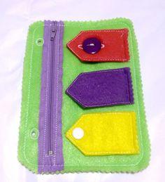 Green Quiet Closures zipper, button, snap, and velcro quiet book book