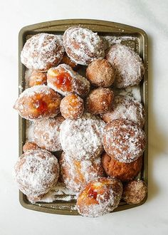 Jelly Donuts Recipe by The Wood and Spoon Blog by Kate Wood. Find the recipe for these fluffy yeast doughnuts filled with fruity jam and covered with sugar. These are fried donuts that are tossed in cinnamon sugar, powdered sugar, or granulated sugar.