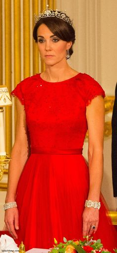 Catherine, Duchess of Cambridge wearing a Jenny Packham bespoke red gown with cap sleeves with sequins, some lace overlay, at least in bodice, and full skirt along with the Lotus Flower tiara for the state banquet at Buckingham Palace for Chinese President Xo Jinping, October 20, 2015.