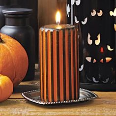 """Black and orange stripes make this pillar perfect for your Halloween happenings! Fragranced with Halloween Night™ – the scent of rich butterscotch, vanilla and spices slowly stirred into a batch of warm, sugary caramel. Burn time: 65-70 hours. 3""""x5"""". By PartyLite Candles, decorations, centerpiece, fall"""