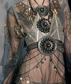 Drape over sheer  John Galliano, Fall 2009  Like the layers, creates lots of interest.