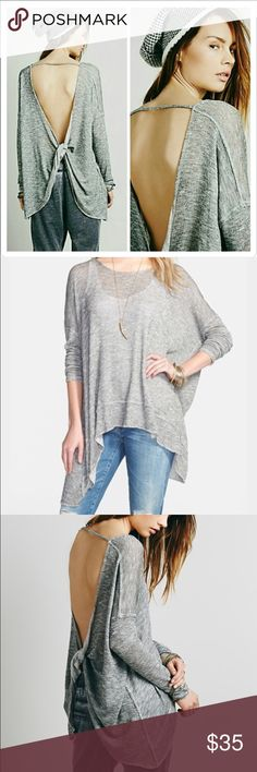 Free People Shadow Hacci Free People Shadow Hacci top in grey. Has a twist back and oversized fit. True to size in the arms. Great condition. Free People Tops Tees - Long Sleeve