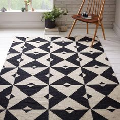 Our Graphic Tile Wool Dhurrie rug is our take on classic floor tiles, with a…