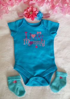 Newborn Baby Girl Teal Onsie with Matching Headband.  You can buy the socks to go with it, too  Cute Baby Christmas Gift  This outfit is on a 22in Reborn Doll  Headband measures 13in not stretched