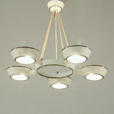 Anonymous; Brass and Painted Metal Chandelier by Stilnovo, 1950s.