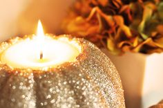 glitter pumpkin candle-could do even without the glitter!