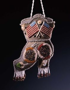 Beaded Whimsy, Niagara Falls style, circa 1900, Unidentified Seneca/Iroquois Artist, glass beads on cardboard-reinforced cotton with wool and sawdust 15 7/8 x 7 x 2 3/8 in. (40.2 x 17.7 x 6.0 cm) Smithsonian American Art Museum, Gift of Herbert Waide Hemphill, Jr. and museum purchase made possible by Ralph Cross Johnson 1986.65.356