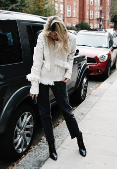 Details details details. Opt for a statement sweater like this asymmetrical fringe knit paired with copped jeans and ankle boots
