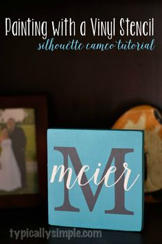 This personalized family name sign is made with chalk finish paint using the vinyl stencil method and a Silhouette Cameo for the stencils. | typicallysimple.com