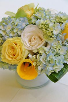 Yellow, white and blue wedding centerpiece