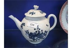 "lot 226 A FIRST PERIOD WORCESTER PORCELAIN TEAPOT with blue fruit and flower decoration on white ground, 6.25"" high"