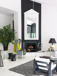 White and Gray Living Room With Black Fireplace, high ceilings. Lofty living.   Patrick Mele.