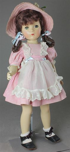 "20"" MADAME ALEXANDER HARD PLASTIC ""MARGARET O'BRIEN"" IN TAGGED PINK CHECK DRESS WITH APRON ~ PROFESSIONAL RESTORATION LIKELY TO HEAD, OUTFIT HAS BEEN LAUNDERED AND SHOWS ONLY MINOR WEAR"