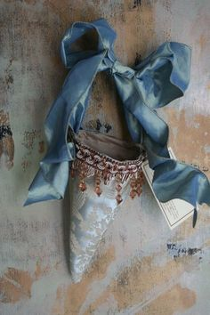 victorian fabric cone w/ beaded trim... I would like to make these from scrapbooking paper, sheet music or pages from old books....