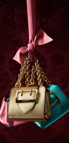 96b8974776af The Burberry Mini Buckle Tote in metallic leather is detailed with a  regimental belt and polished