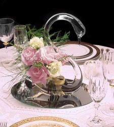 elegant, clear glass swan vase wedding centerpiece with pink and cream roses