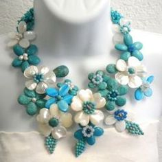 Shop for Pearl and Gemstone Grand Floral Bouquet Necklace mm) (Thailand). Get free delivery On EVERYTHING* Overstock - Your Online Jewelry Destination! Garnet Gemstone, Gemstone Jewelry, Jewelry Crafts, Jewelry Art, Jewelry Ideas, Custom Jewelry, Handmade Jewelry, Mother Of Pearl Necklace, Beaded Jewelry Patterns