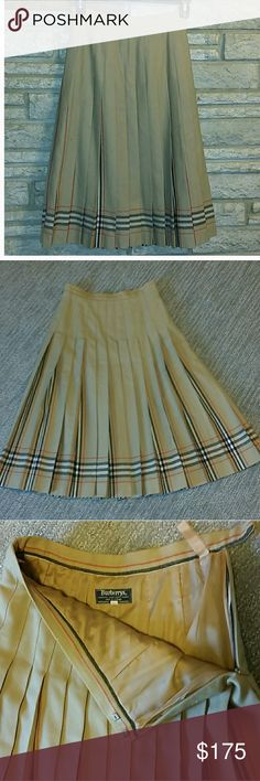 Burberry Skirt Burberry Skirt 28. 5 inches long, 27. 5 inches around the waist. Good condition, no stains or rips. 100 % Wool, perfect for fall / winter. Burberry Skirts
