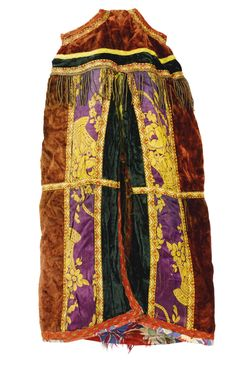 A Moroccan Torah Mantle, circa 1900  ~   velvet and metallic thread fringes with a large  tassel of multicolored silk thread and decorative braiding, lined with multi-colored printed cotton floral cloth. height 27 in.; width 17 in.  (68.6 cm; 43.2 cm)