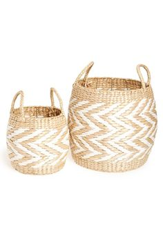 Smart chevrons lend elegant, geometric sophistication to these drum-shaped baskets made from straw that's perfect for holding magazines, toys or other home goods.