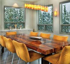 This is an example of a contemporary dining room in Toronto with white walls and medium hardwood floors. In the formal dining room, a chandelier emphasizes the room's high ceiling, and Meisels' vintage vase collection adds color to a clean-lined dining set. ➤Discover the season's newest designs and inspirations. Visit us at www.moderndiningtables.net #diningtables #homedecorideas #diningroomideas @ModDiningTables